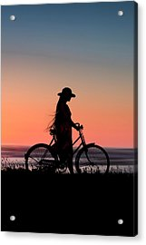 Silhouette Of Girl And Bike At Sunset Near The Sea. Acrylic Print