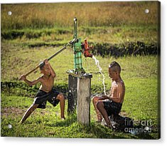 Two Young Boy Rocking Groundwater Bathe In The Hot Days. Acrylic Print by Tosporn Preede