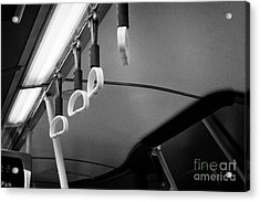Yellow Hand Holds For Standing Customers On A Bus In The Uk Acrylic Print by Joe Fox