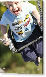 Young Boy Smiling Swinging In A Swing Acrylic Print by Robert Postma
