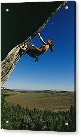 A Young Woman Climbing The Rock Feature Acrylic Print by Bobby Model