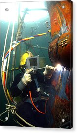 U.s. Navy Diver Welds A Repair Patch Acrylic Print by Stocktrek Images