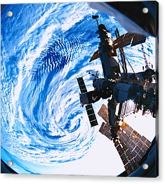 A Space Station Orbiting Above Earth Acrylic Print by Stockbyte