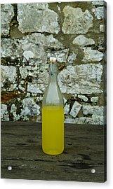 A Bottle Of Limoncello Sits On A Picnic Acrylic Print by Todd Gipstein