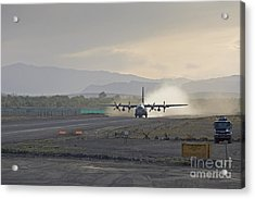 A C-130 Taking Off Acrylic Print by Tim Grams