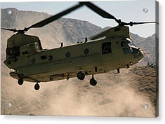 A Ch-47 Chinook Helicopter Kicks Acrylic Print by Stocktrek Images