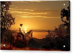 A Cowboy Riding On His Horse Into A Yellow Sunset. Acrylic Print by Peter Nowell