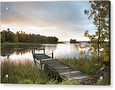 A Dock On A Lake At Sunrise Near Wawa Acrylic Print by Susan Dykstra