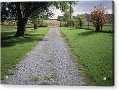 A Gravel Road Marks The Entranceexit Acrylic Print by Joel Sartore
