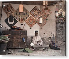 A Kite Merchant Sits In His Store Acrylic Print by Gervais Courtellemont