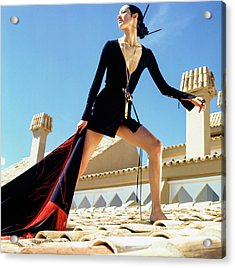 A Model On A Rooftop In A Dress By Paraphernalia Acrylic Print by Henry Clarke