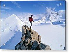 A Mountain Climber Summits Mount Acrylic Print by Gordon Wiltsie