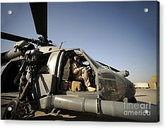 A Pilot Sits In The Cockpit Of A Hh-60g Acrylic Print by Stocktrek Images