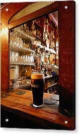 A Pint Of Dark Beer Sits In A Pub Acrylic Print