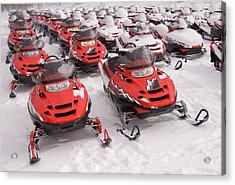 A Row Of Snowmobiles Sit Waiting Acrylic Print by Taylor S. Kennedy