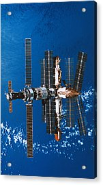 A Space Station Orbiting In Space Acrylic Print by Stockbyte