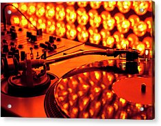 A Turntable And Sound Mixer Illuminated By Lighting Equipment Acrylic Print by Twins