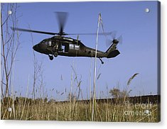 A U.s. Army Uh-60 Black Hawk Helicopter Acrylic Print by Stocktrek Images