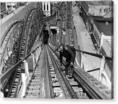 A Workman Greases Up The Tracks Acrylic Print by Everett