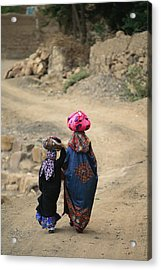 A Yemeni Woman And Child Carrying Acrylic Print by Michael Melford