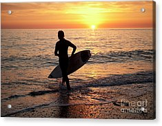 A Young Man Surfing At Sunset Off Aberystwyth Beach, Wales Uk Acrylic Print