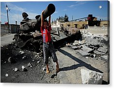 A Young Syrian Boy Plays On The Turret Acrylic Print by Andrew Chittock