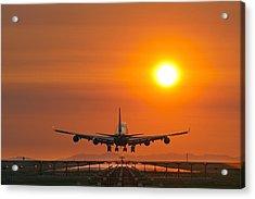 Aeroplane Landing At Sunset Acrylic Print by David Nunuk