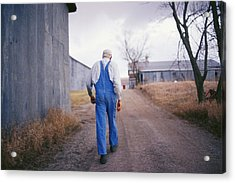 An Elderly Farmer In Overalls Walks Acrylic Print by Joel Sartore