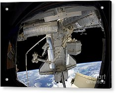 Astronaut Participates In A Spacewalk Acrylic Print by Stocktrek Images