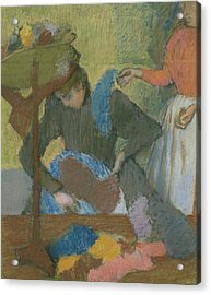 At The Hat Maker Acrylic Print by Edgar Degas