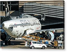 Austrian Star Alliance At Preparation Aircraft Befthe Gate Of Zurich Acrylic Print by Roberto Chiartano