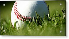 Baseball In Grass Acrylic Print by Chris Brannen