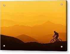 Biker Riding On Mountain Silhouettes Background Acrylic Print