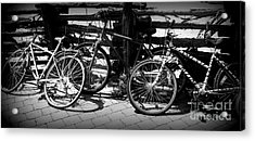 Black And White Leaning Bikes Acrylic Print by Emily Kelley