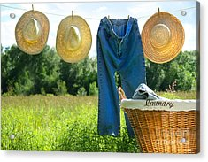 Blue Jeans And Straw Hats On Clothesline Acrylic Print by Sandra Cunningham