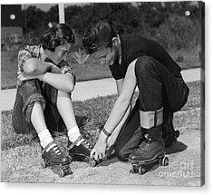Boy Helping Girl With Roller Skates Acrylic Print