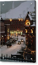 Carriage And Slded On Snowy Steets Acrylic Print by Paul Chesley