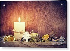 Chistmas Decoration With Candle Glowing On Wooden Wall Background Acrylic Print