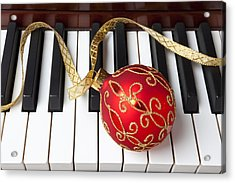 Christmas Ornament On Piano Keys Acrylic Print by Garry Gay