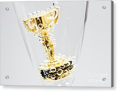 Closeup Of Small Trophy In Champagne Flute. Gold Colored Award I Acrylic Print by Jorgo Photography - Wall Art Gallery