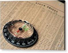Compass On Stockmarket Cotation In Newspaper Acrylic Print by Sami Sarkis