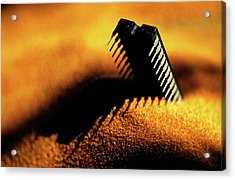 Computer Chip Half-buried In Sand Acrylic Print by Sami Sarkis