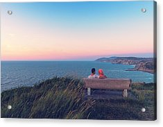 couple on bench vith view of Sopelana coast Acrylic Print