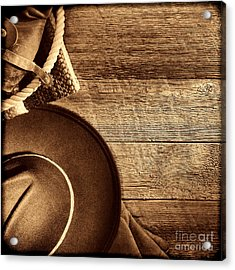 Cowboy Hat And Gear On Wood Acrylic Print