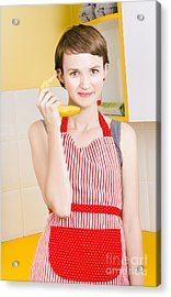 Cute Girl Talking On Fruit Phone In Kitchen Acrylic Print by Jorgo Photography - Wall Art Gallery
