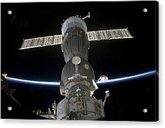 Earths Limb Intersects A Soyuz Acrylic Print by Stocktrek Images