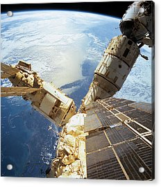 Elevated View Of A Space Station In Orbit Acrylic Print by Stockbyte