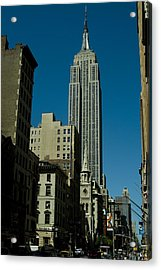 Empire State Building Seen From Street Acrylic Print by Todd Gipstein