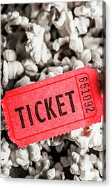 Event Ticket Lying On Pile Of Popcorn Acrylic Print