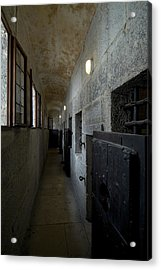 Hallway With Doors To Cells Acrylic Print by Todd Gipstein